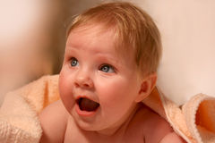 Smiling baby in bath towel Stock Images
