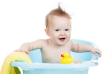 Smiling baby bathing Stock Photography