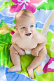 Smiling baby on a beach towel Royalty Free Stock Images