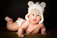 Smiling baby in bear cap royalty free stock photo