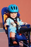 Smiling baby in bicycle seat. Happy baby in bicycle chair Stock Photo