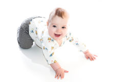 Smiling baby boy. Crawling on the floor Stock Images