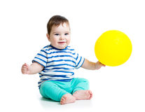 Smiling baby boy with balloon in his hand. Smiling baby boy with ballon in his hand on white Royalty Free Stock Images