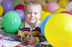Smiling baby boy with balloons. Stock Photo