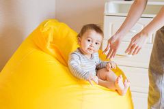 Smiling baby boy child sits on a chair Royalty Free Stock Photography