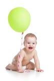 Smiling baby boy with green ballon Stock Photos