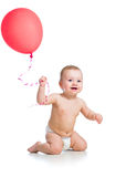 Smiling baby boy with red ballon Royalty Free Stock Photo
