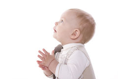 Smiling baby-boy in a suit claps. Smiling baby in a beige suit and tie claps. On a white background Stock Photo