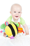 Smiling baby boy with toy Royalty Free Stock Image