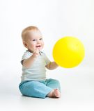 Smiling baby boy with yellow ballon in his hand. Smiling kid boy with yellow ballon in his hand Royalty Free Stock Photo