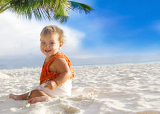 Smiling baby child on tropical sand beach royalty free stock image