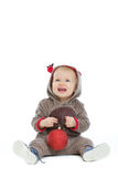 Smiling baby with Christmas ball Stock Images