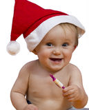 Smiling Baby with a christmas hat Royalty Free Stock Images