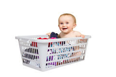 Smiling Baby in clothes basket Royalty Free Stock Photo