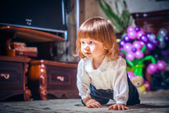 Smiling baby crawling Stock Photo