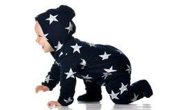 Smiling baby crawls isolated on white stock image