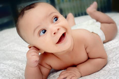 Smiling baby in diapers Stock Images