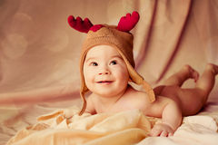 Smiling baby dressed in christmas deer hat Royalty Free Stock Photos