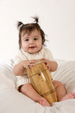 Smiling baby with drum. Adorable smiling baby girl playing with drum Stock Photo