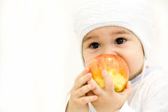 Smiling baby eating banana and many kinds of fruit and bowl with yoghurt Royalty Free Stock Images