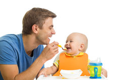 Smiling baby eating food Royalty Free Stock Photo