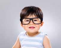 Smiling baby with eye wear stock image