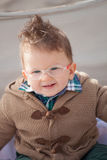 Smiling baby with eyeglasses Royalty Free Stock Photography