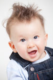 Smiling baby with fancy haircut in studio Stock Image