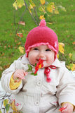 Smiling baby with flower Stock Image