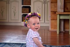 Smiling baby with flowers wreath stock photos