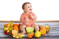 Smiling baby and fruits Royalty Free Stock Photos