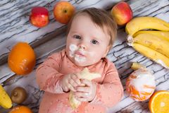 Smiling baby and fruits Royalty Free Stock Photo