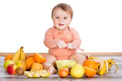 Smiling baby and fruits. Smiling baby and many kinds of fruit and bowl with yoghurt Stock Photos