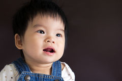 Smiling baby girl. Happy little baby girl smiling isolated in black background Stock Photography