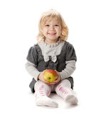 Smiling baby girl with apple Stock Photo