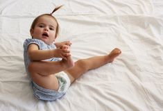 Smiling baby girl on the bed. Looking at camera. Place for copy Royalty Free Stock Photo