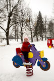 Smiling Baby Girl on Bouncy Spring Rider Motorcycle Stock Image