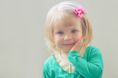 Smiling baby girl with bow royalty free stock images