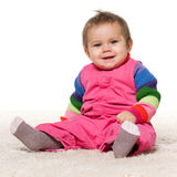 Smiling baby girl on the carpet Stock Image