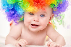 Smiling baby girl with colorful wig Royalty Free Stock Photo