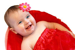 Smiling baby girl dressed in red skirt Royalty Free Stock Image