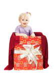 Smiling baby girl in gift box Stock Photography
