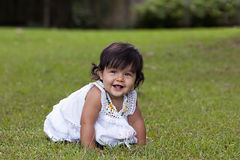 Smiling Baby Girl in Grass Royalty Free Stock Image