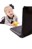 Smiling baby  girl with laptop isolated Stock Photos