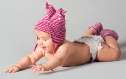 Smiling baby girl lying stock photo