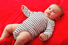 Smiling Baby Girl are Lying in the Bed Stock Photography