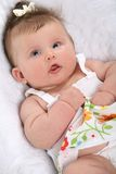 Smiling Baby Girl Lying Down on the Bed Royalty Free Stock Photo