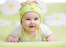 Smiling baby girl over flower Stock Photography