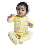 Smiling Baby Girl Playing with a Rattle Royalty Free Stock Image