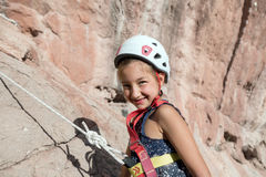 Smiling baby Girl in protective Rock climbing Helmet Portrait Stock Images